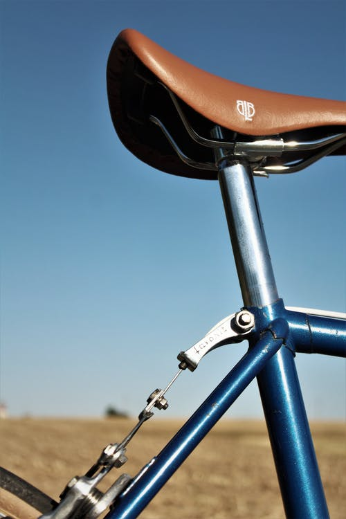 Blue and Silver Bicycle on Brown Field