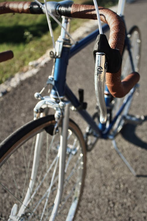 Blue and Black Bicycle on Gray Concrete Road