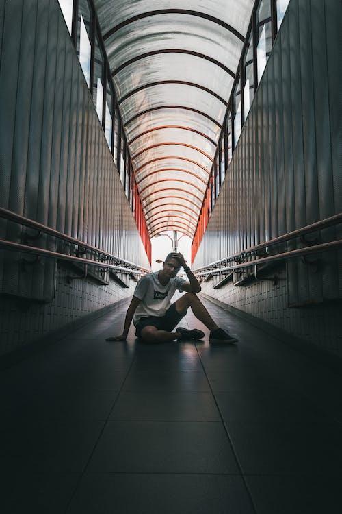 Man on Floor at Metro Station