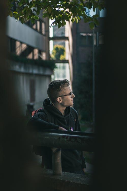 Young Man in Black Hoodie Wearing Eyeglasses