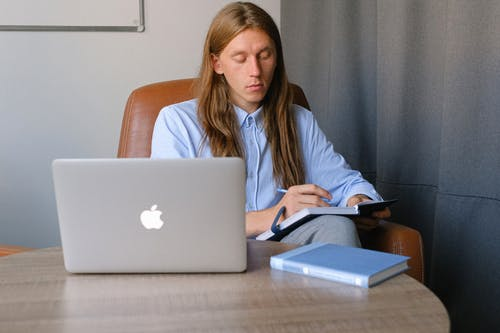 Concentrated man working in office