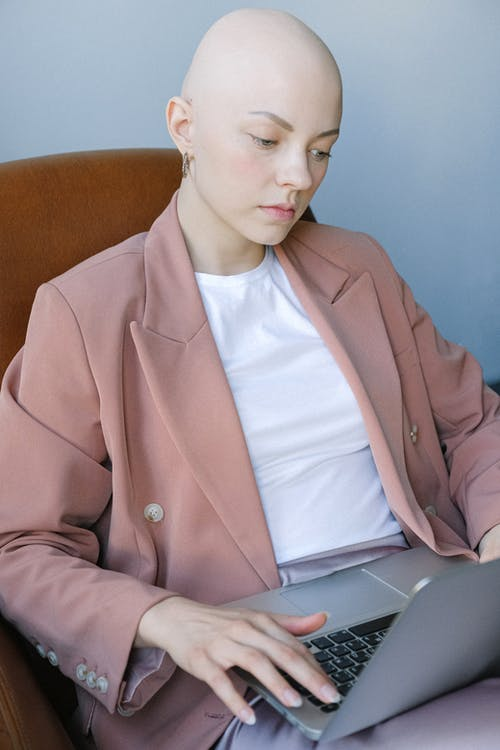 Busy young businesswoman surfing laptop while working alone