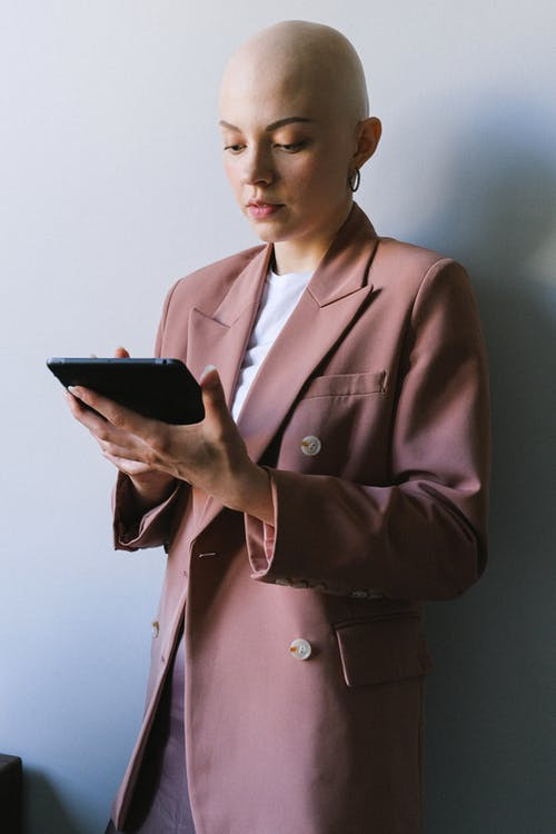 Serious businesswoman using tablet for work