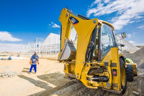 Yellow Excavator on Gray Sand