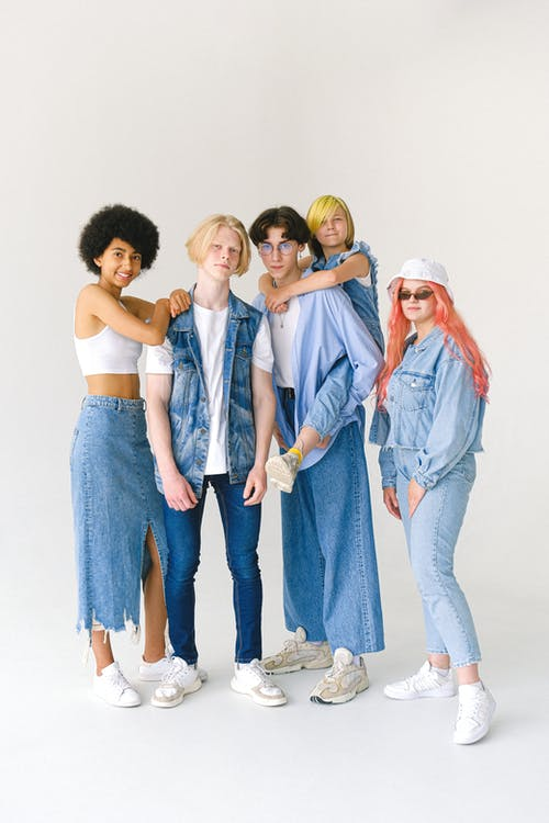 Group of friends in denim outfits