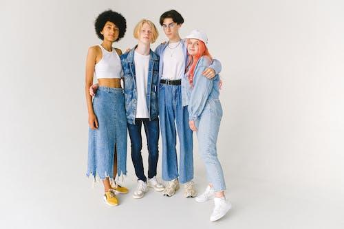 Multiethnic group of teenagers standing in studio