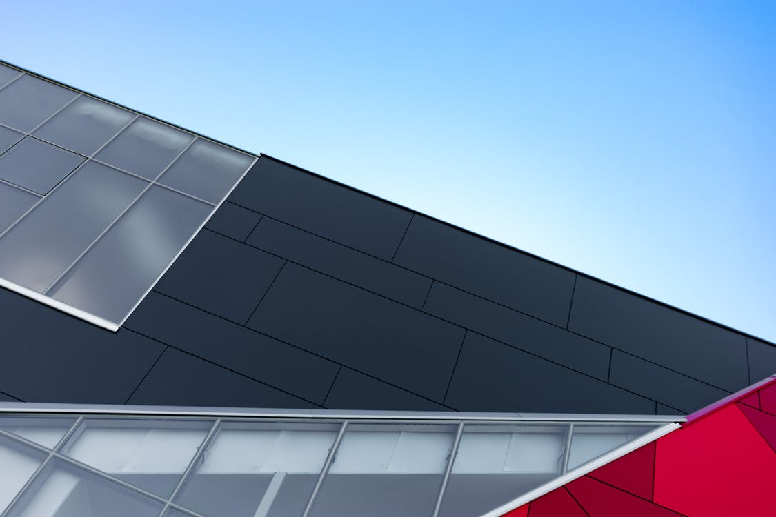 Low Angle Photography of Black and Silver Building