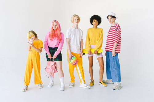 Stylish diverse friends in colorful clothes