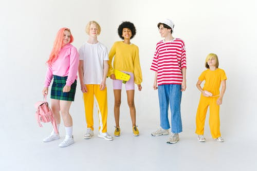 Cheerful diverse friends in colorful wear