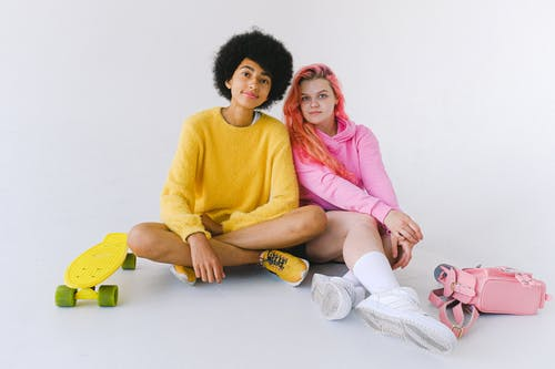Content multiethnic teens with bright skateboard