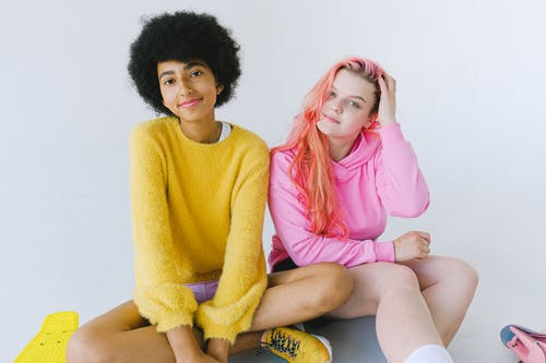 Delighted happy diverse teenage girls in trendy outfit