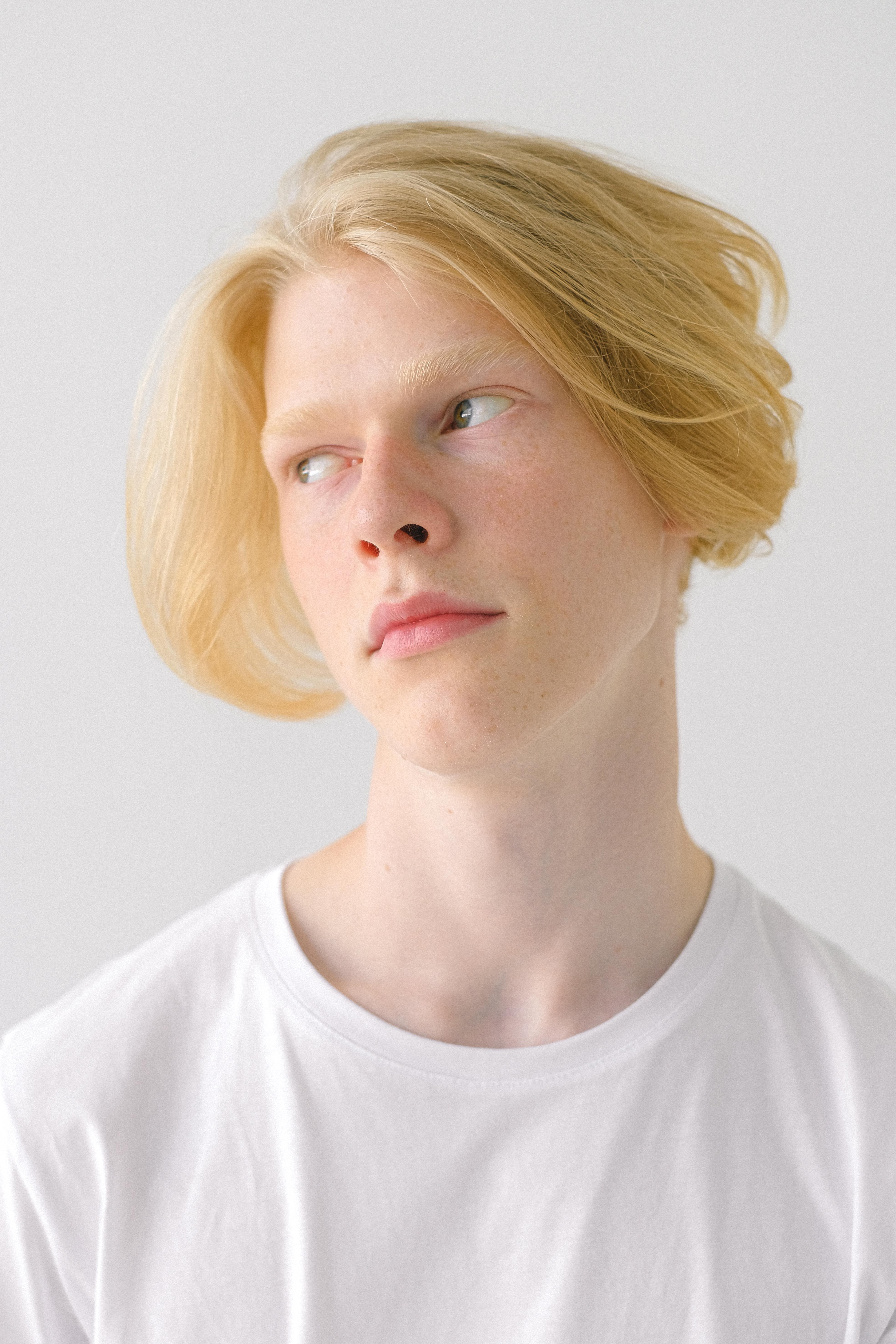 thoughtful teenage boy with stylish haircut