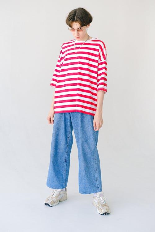 Teenage boy in bright oversize T shirt gazing