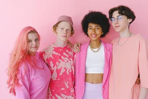 Cheerful fashionable multiethnic teenage boys and girl