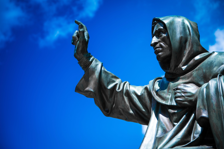 Man Raising Hand Statue