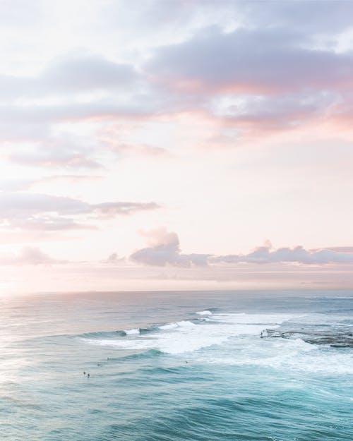 Wavy sea under colorful sky