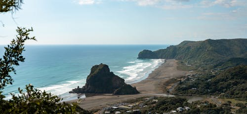 Wavy ocean washing rocky coast