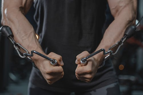 Person Holding Gray Metal Chain