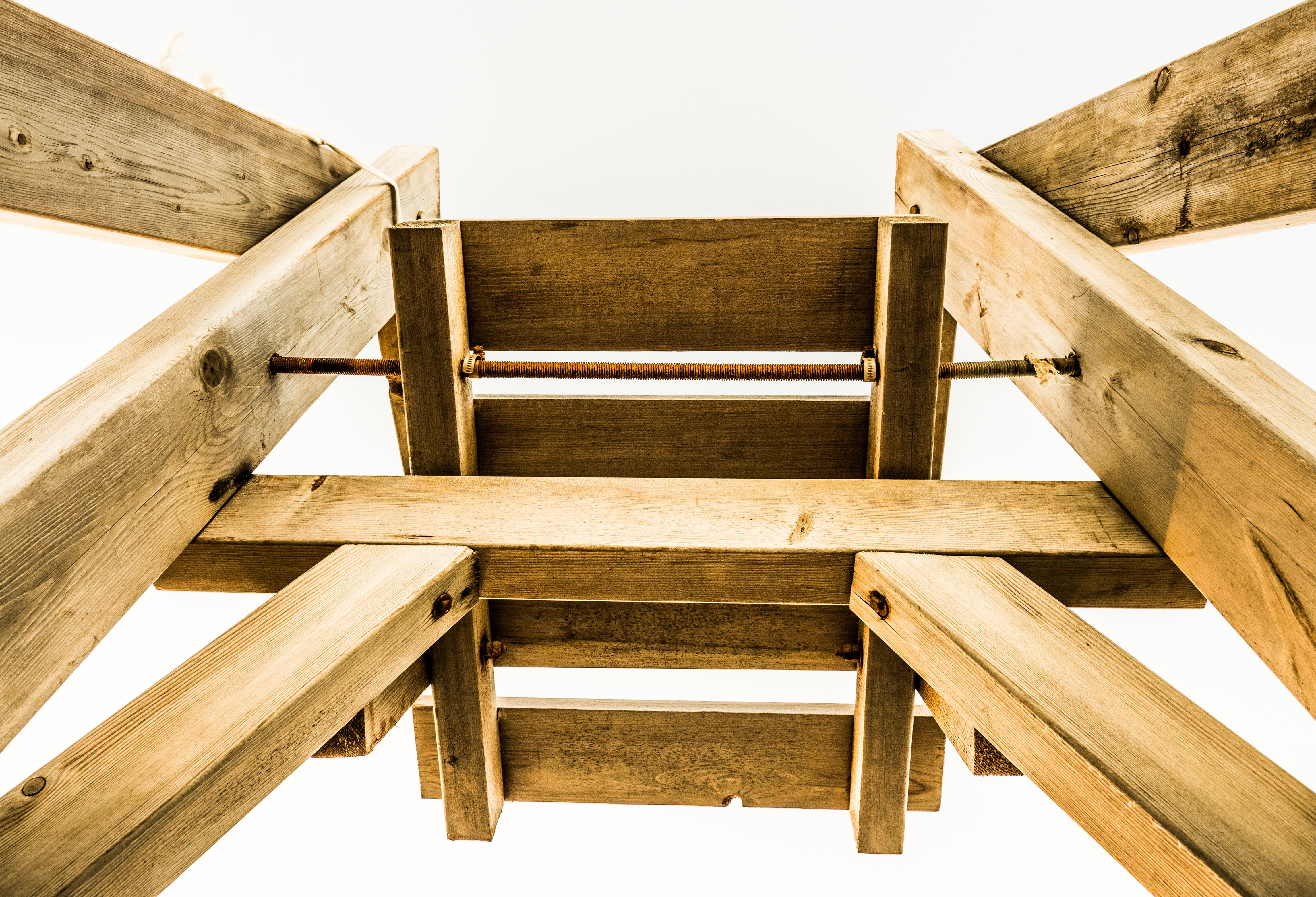 Low-angle Photography of Brown Wooden Stand