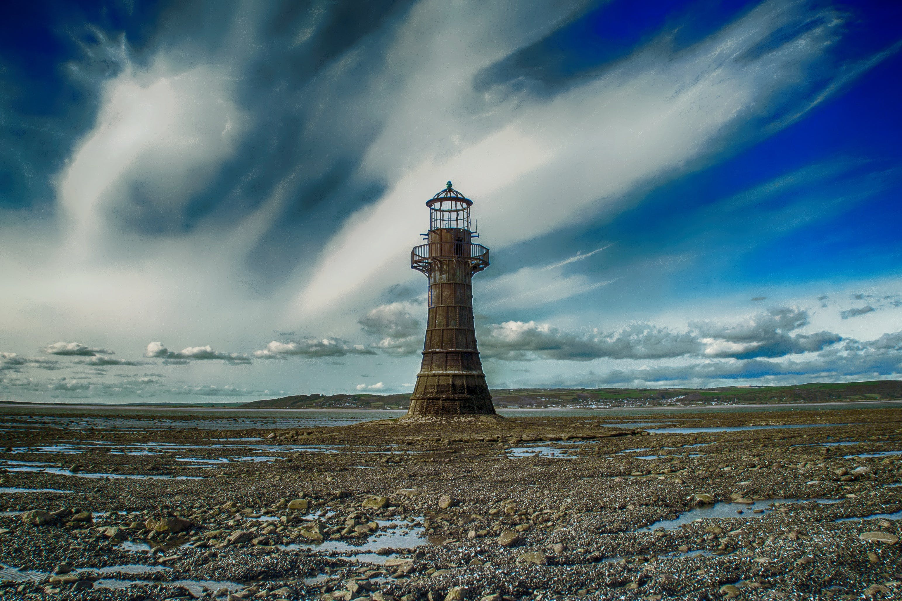 Beige Lighthouse Under White Clouds