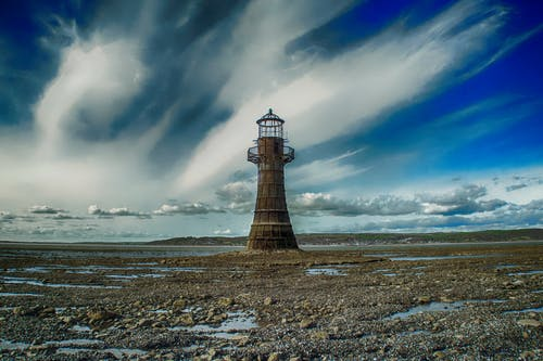 Безкоштовне стокове фото на тему «архітектура, берег моря, вежа, вечір»