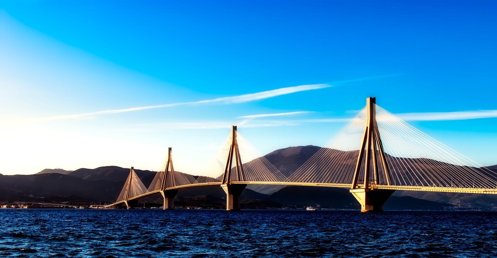 Photo of Brown Suspension Bridge