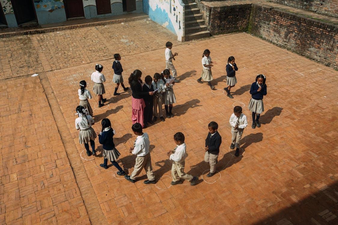 People Walking on Brown Concrete Floor