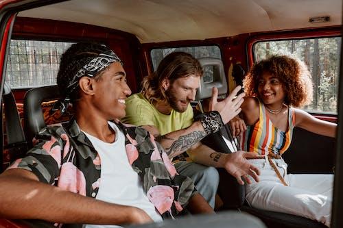2 Women and 2 Men Sitting Inside Car