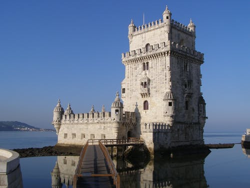 Gray Castle Surrounded With Body of Water
