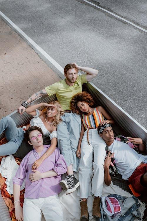 Group of People Lying on Gray Concrete Floor