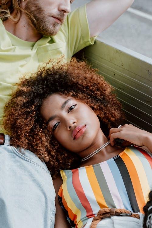Woman in White Orange and Blue Stripe Shirt