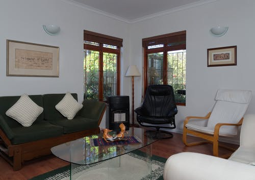 Black Leather Armchair Beside Brown Wooden Table