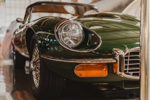 Green Porsche 911 Parked in Close Up Photography
