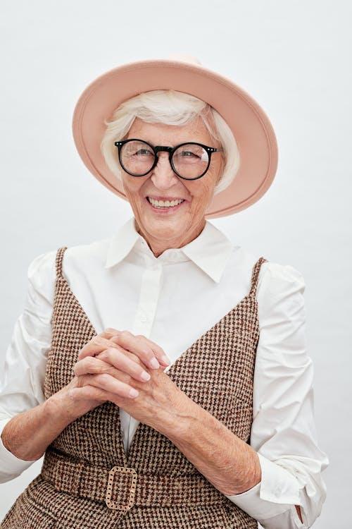 Woman in White Dress Shirt Wearing Brown Hat