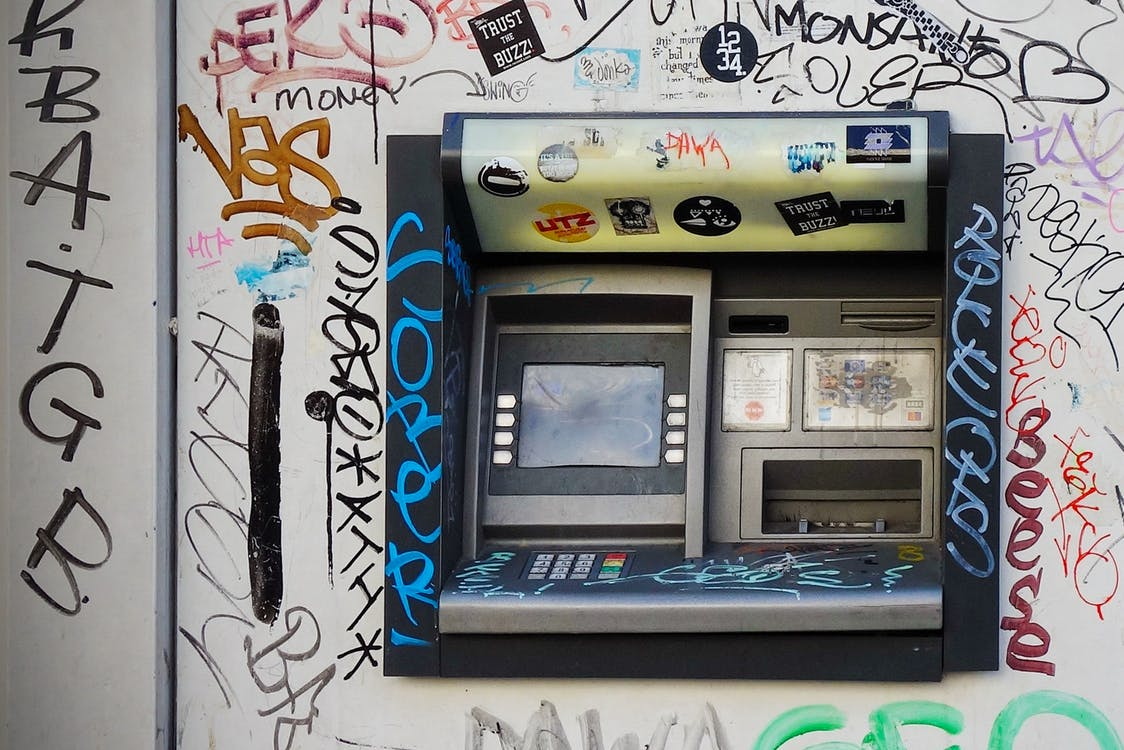 Gray Atm Machine With Graffiti