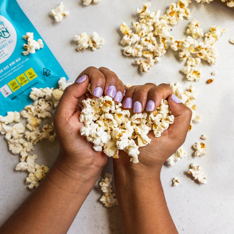 Popcorn on Persons Hand