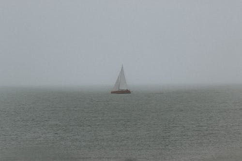 Sailboat floating on calm sea water