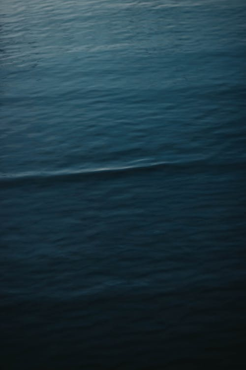 Abstract background of calm lightly rippling surface of powerful ocean in rich ultramarine color