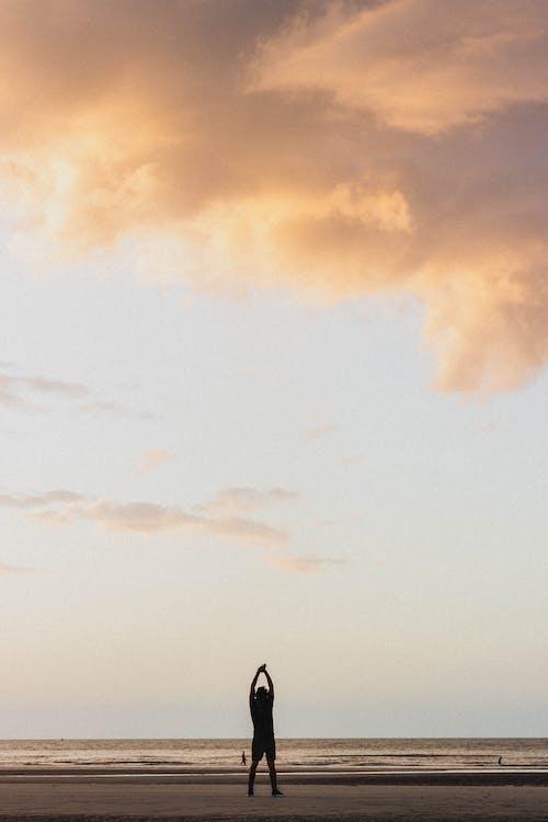 Anonymous traveler standing on seashore