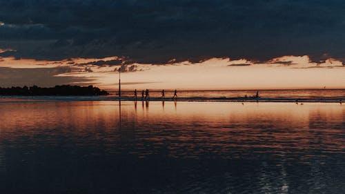 Amazing dark coast under sunset clouds