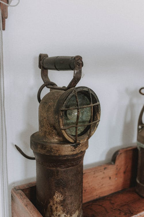 Antique pipe on wooden shelf
