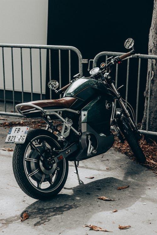 Trendy motorbike parked near shabby building