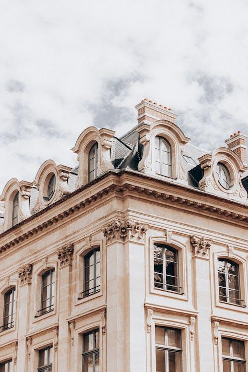Facade of classic building with attic floor