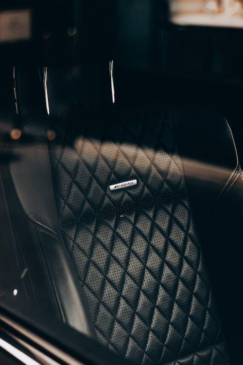 Black leather car seat in sunlight