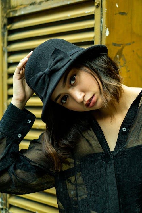 Woman in Black Denim Jacket and Black Hat