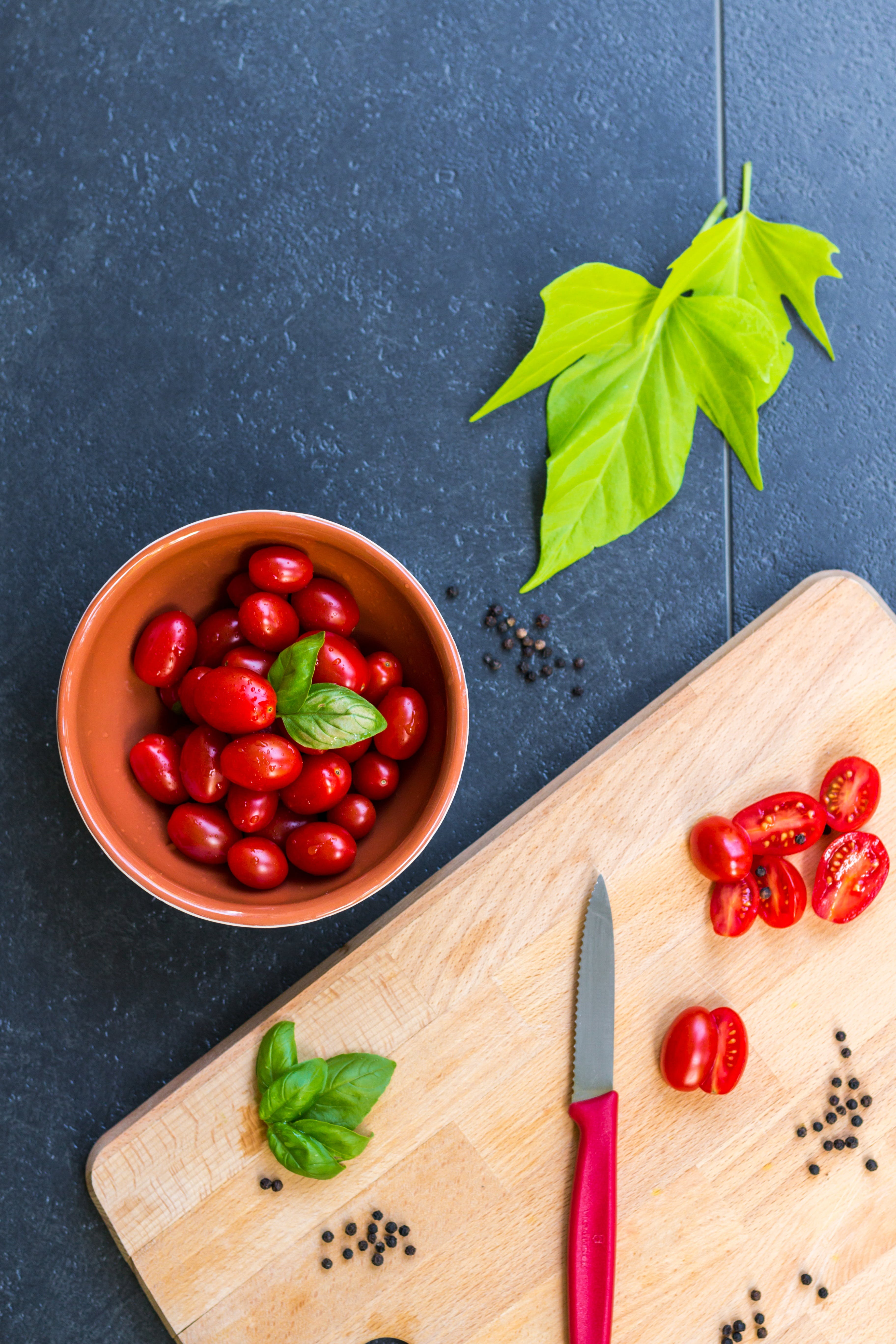 cherry tomatoes, chopping board, cooking