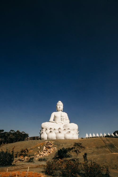 Giant monument of Buddha on hill