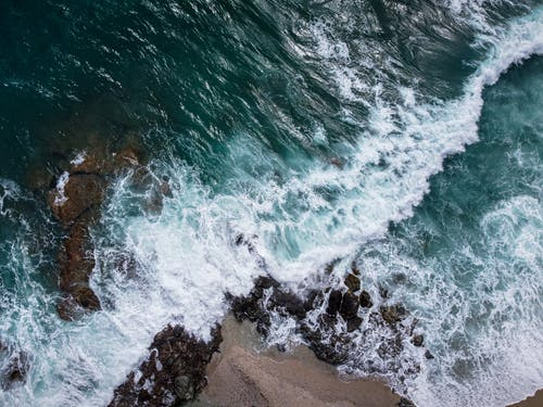 Aerial View of Ocean Waves on Shore