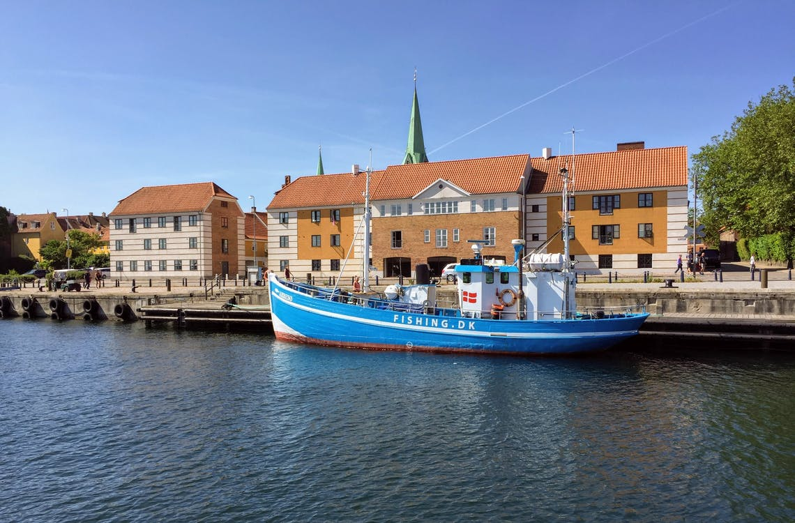 Best places to visit in Denmark. A look at Helsingor's blue boat near its dock.