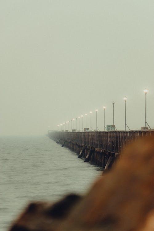 Wooden bridge with streetlights in overcast weather